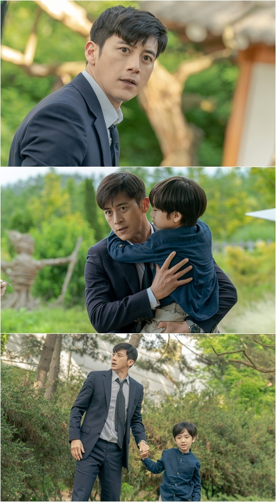 'Missing: The Other Side' Go Soo, holding a boy, captures the escape of the soul village